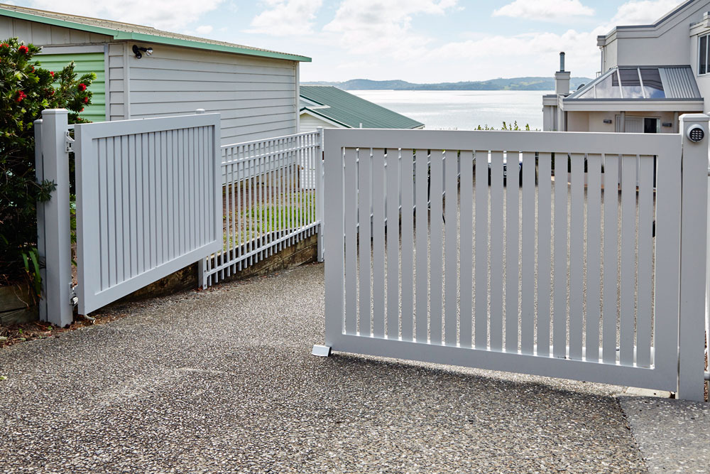 Automated Sanctuary architectural slat gate and Contemporary fencing