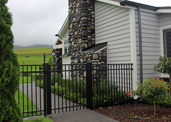 Contemporary Fence and gate on a modern home finishes off the entry to the backyard perfectly IN SATIN BLACK2