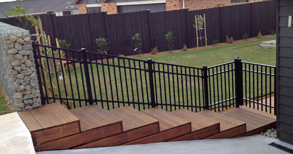 Contemporary fencing on steps for front yard raked panels and matching gates make a perfect modern entranceway2