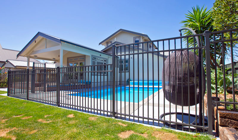 Contemporary pool fencing with matching pool gate by Sayers Industries2